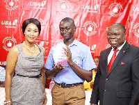 Deputy Minister of Education, Barbara Ayisi Acher with the winner of the UBA Foundation competition