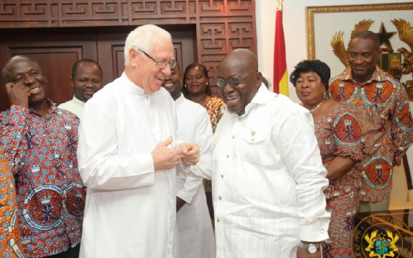 President Akufo-Addo interacting with  Rev. Father Andrew Campbell