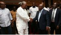 Former president Mahama in a hand shake with President Nana Addo Darkwa Akufo-Addo