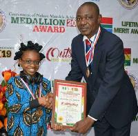 DJ Zel receiving certificate of honour