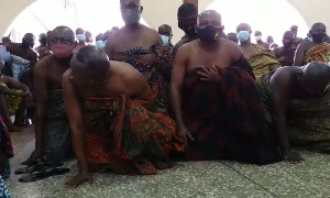 Bantamahene and some elders on their knees as they seek forgiveness