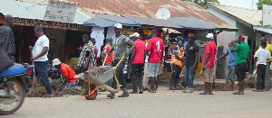 With brooms, spades, rakes and wheelbarrows, residents joined in the clean-up exercise