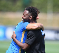 Kwadwo and Conte in a warm embrace