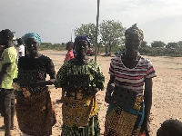 Some women of Ningo-Prampram holding their clean cook steel given to them by the foundation