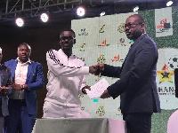 Nana Appiah Mensah with Kwesi Nyantakyi at the signing of the GPL sponsorship