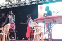 Emmanuella with Mark Angel on stage