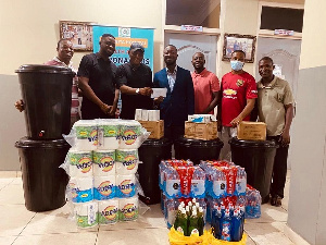 Ampomah's reps presenting the items to the hospital