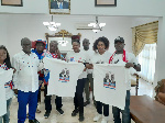 Members of NPP South Africa presenting the shirts