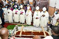 Catholic bishops at the grave during the burial of Archbishop Lwanga at Rubaga Cathedral in Kampala