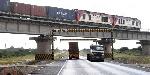 A cargo train crosses the Mombasa-Nairobi highway near Taru in Kwale County