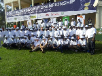 Golfers and organizers in a group photograph doing the opening ceremony