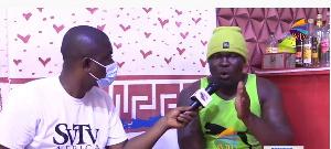 Ghanaian boxer, Bukom Banku [R] granting an interview to SVTV Africa's DJ Nyami
