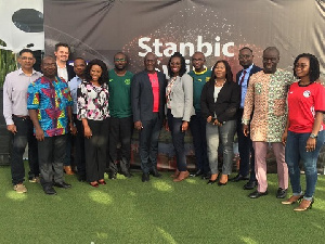 Some staff of Stanbic Bank in a group photo after the programme