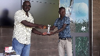 Sasu (R) receiving his prize from Mark Cofie, Vice-captain of the Achimota Golf Club