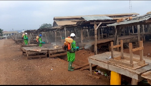 Disinfection exercise being carried out in a market