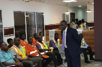 Chief Executive of the DVLA, Kwasi Agyeman Busia interacts with staff of the authority.