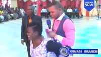 Obinim being carried by a lady in his church