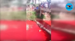 A tie-and-dye powder was poured into the river