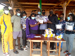 The Ghana Beach Volleyball receiving the items