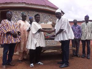 Mion Lana, Alhaji Abdulai Mahamadu receiving the donated items