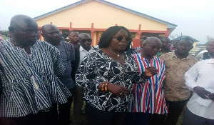 Upper East Regional Minister, Tangoba Abayage inspecting the facility