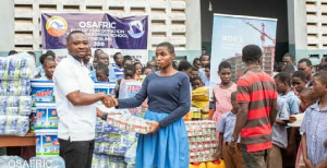 OSAFRIC official hands over items to the school