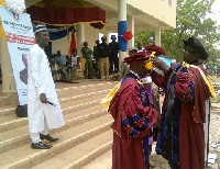 Polytechnic Council Chairman Professor Bagah, decorating the new Rector with the official robes
