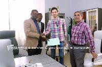 Kurt E.S. Okraku (L) with officials of Ezzy Paints