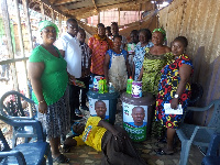 Emmanuel Adotey Allotey with some of the market women