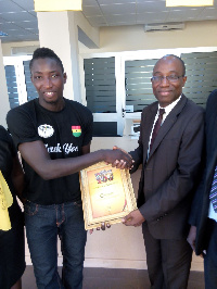 Enoch Donkor CEO of Global Access receives a certificate of appreciation from Afcon 2015 Beach Socce