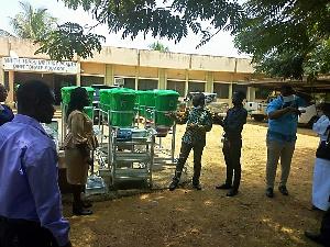 Kobena Mensah Woyome presenting the equipment to the directorate