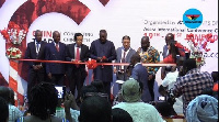 Business Development Minister, Chinese Ambassador to Ghana and others cutting the tape