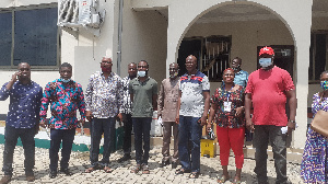 The regional Chairman in a group photo with party executives and Mr Sam Atta Mills