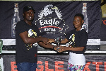 Brand Manager of Eagle Extra Stout, John Akado presenting to Grace Commey