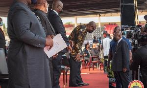 John Dramani Mahama, leader of the National Democratic Congress bowing to Akufo-Addo