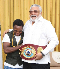 Isaac Dogboe and his team paid a courtesy call on former President Rawlings