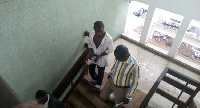 Akwasi Emmanuel in handcuffs with the Police