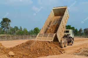 File photo of a truck offloading sand