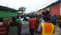 The protesters threatened to pull down a wall constructed by Melcom Ghana
