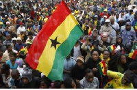 A Ghanaian holding the country's flag