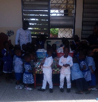 Mr John Akutam in group photograph with some of the orphans