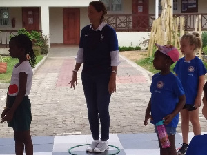 French Ambassador to Ghana, Madam Anne Sophie with some of the kids