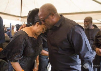John Dramani Mahama consoling the wife of the late Lee Ocran