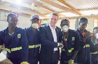 Iain Walker with workers of Booomers