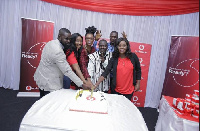 Super Care Vodafone management and leadership of Deaf Union cutting the first Anniversary cake