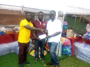 Executives of S.O Frimpong Transport Limited donating the items to Save Them Young Orphanage