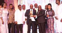 President Akufo-Addo presenting overall best Industrial Company of the year award to Tropical Cables