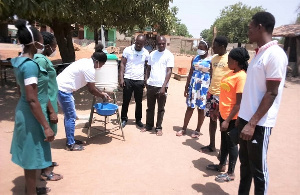 The Team Of NABCO Heal Ghana Health Professionals Demostrating Proper Handwashing To The Public.jpeg