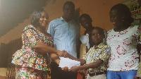 Prosper Diapim of  Mawuli Basic School receiving his price