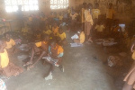 Pupils packed in a classroom without adequate furniture
